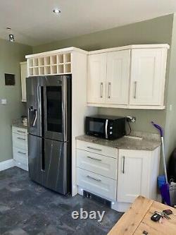 Cream Kitchen including Granite worktops, dishwasher and under counter fridge